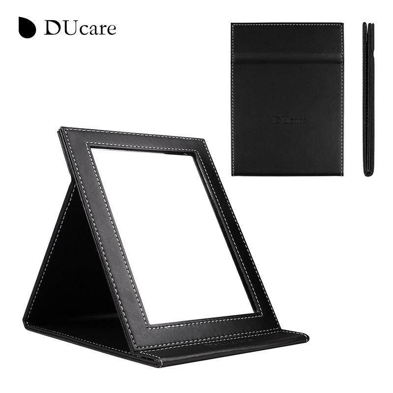 DUcare 1pc New Korean fashion leather PU cosmetic mirror portable folding utility creative school desktop mirror free shipping