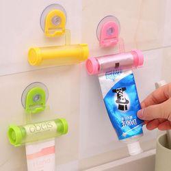 Plástico Rolling tube squeezer útil Pasta de dientes fácil dispensador titular del baño para la decoración del baño 6z-cx317-3