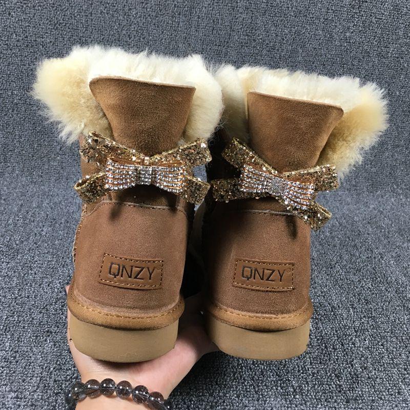 2017 de alta calidad nuevo tipo de arco atado botas para la nieve, 100% natural de piel de oveja Australiana, uno femeninos entrega gratuita