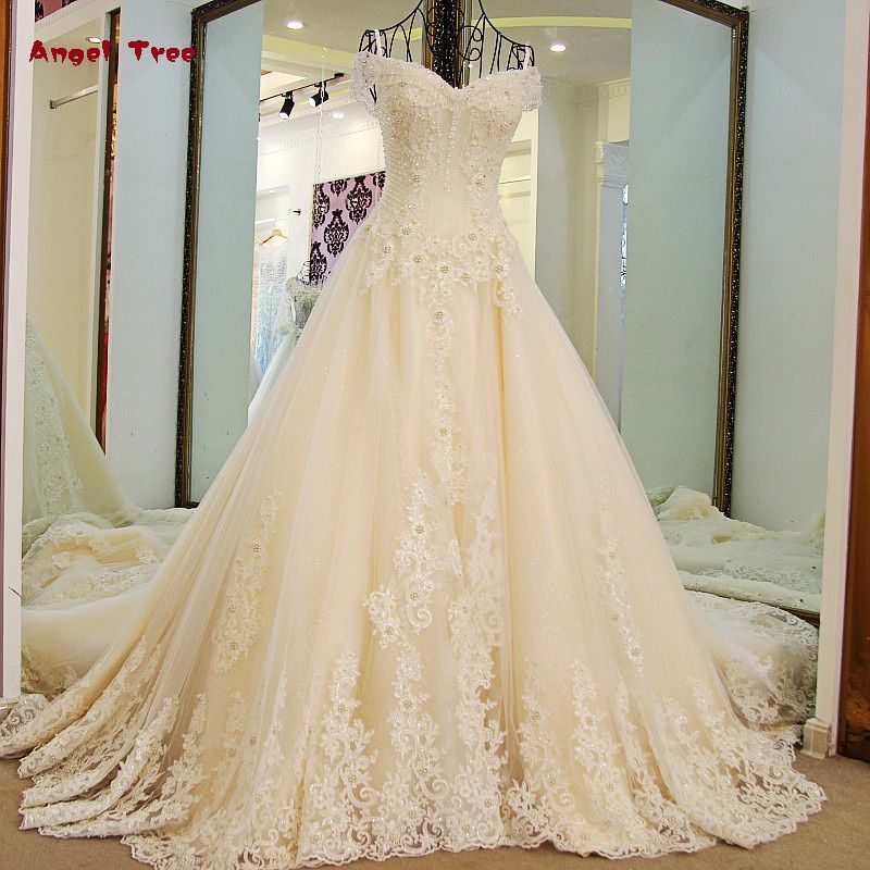 2018 Angel Tree A-line Luxury Wedding Dresses Full Pearls Appliques Crystal Boat Neck Lace Bridal Gowns Vestido De Noiva