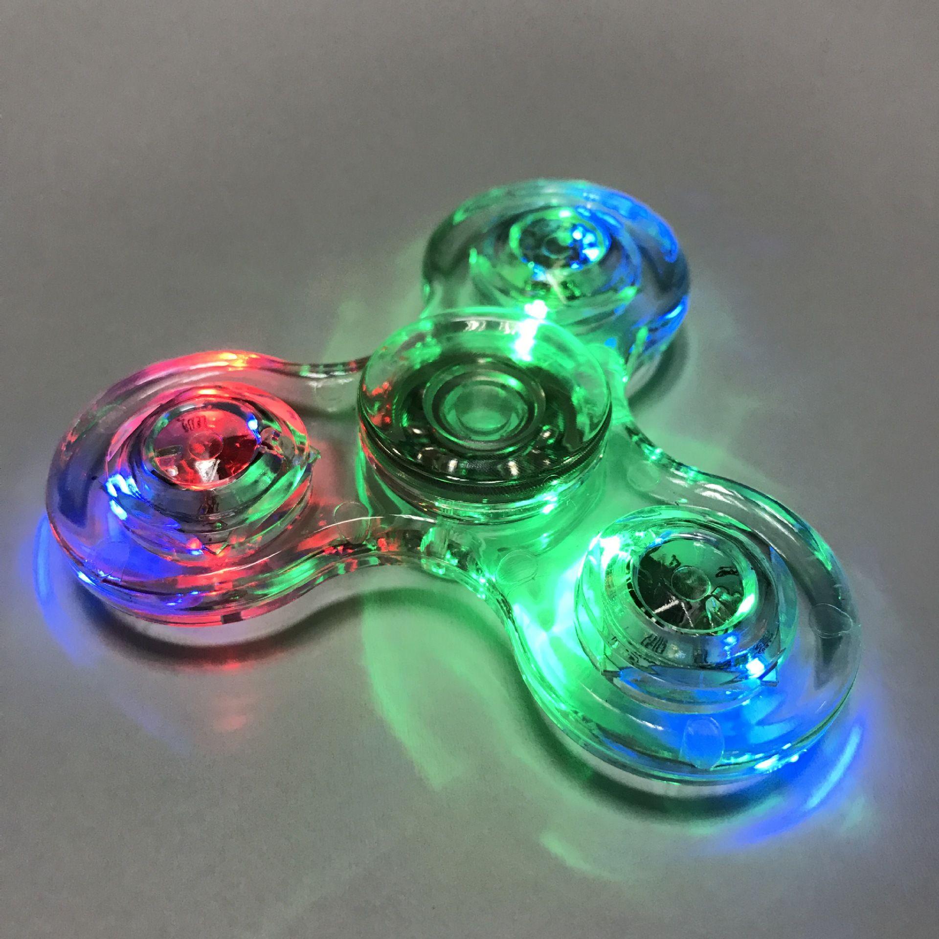 Neue Tri-Spinner Transparente LED-Licht Spinner Kristall Kunststoff EDC Schalter Finger handspinner Autismus Relief Angst Stress Spielzeug