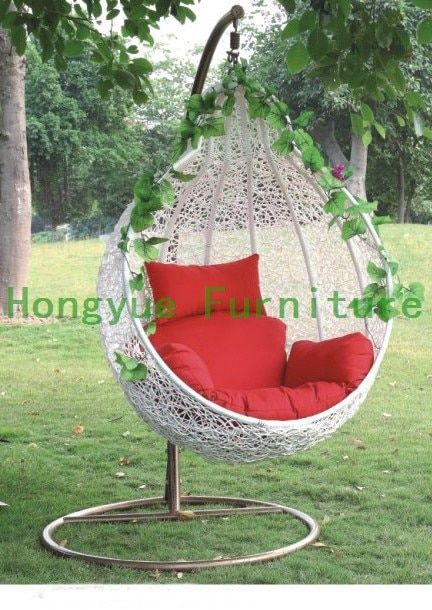 Outdoor white rattan garden swing chair with cushions