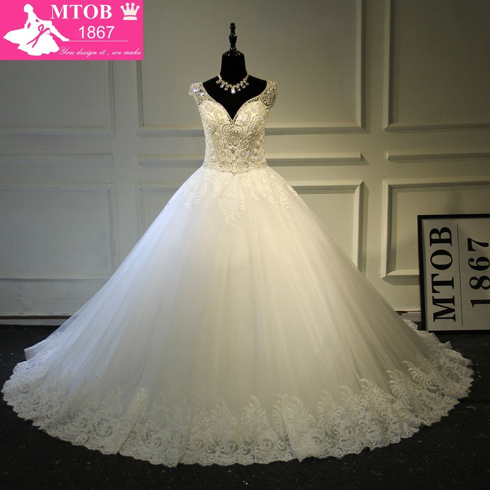2018 Luxury Shiny Crystals Beading Pearls Puffy Ball Gowns Sweetheart Sexy Deep V Backless Wedding Dresses Real Photos MTOB1727