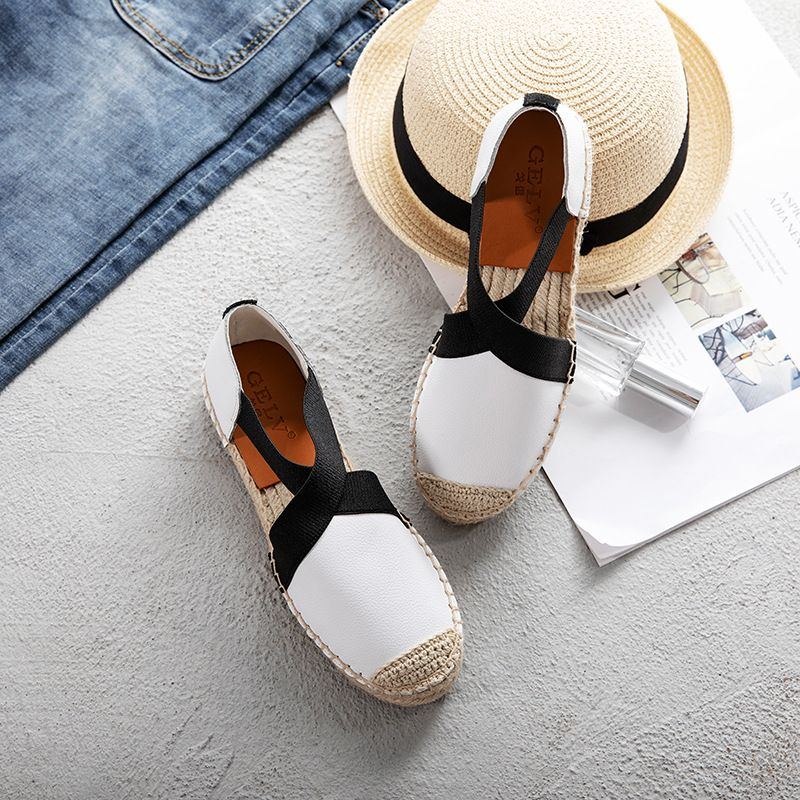 New fisherman shoes female Korean casual wild linen straw leather sandals flat student lazy shoes.