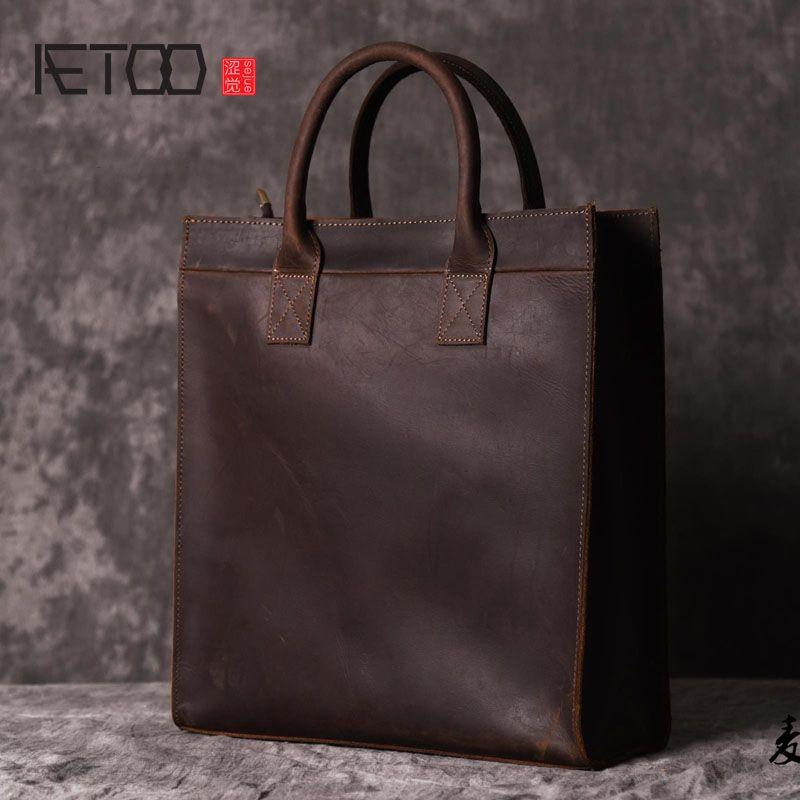 AETOO Men 's vertical handbag European and American shoulder Messenger bag business leather file package retro simple