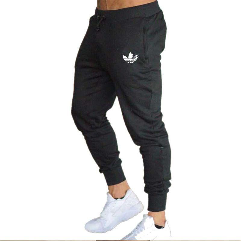2019 nouveaux hommes survêtement s marque hommes pantalons pantalons décontractés pantalons de survêtement gris décontracté élastique coton gymnases Fitness entraînement pan