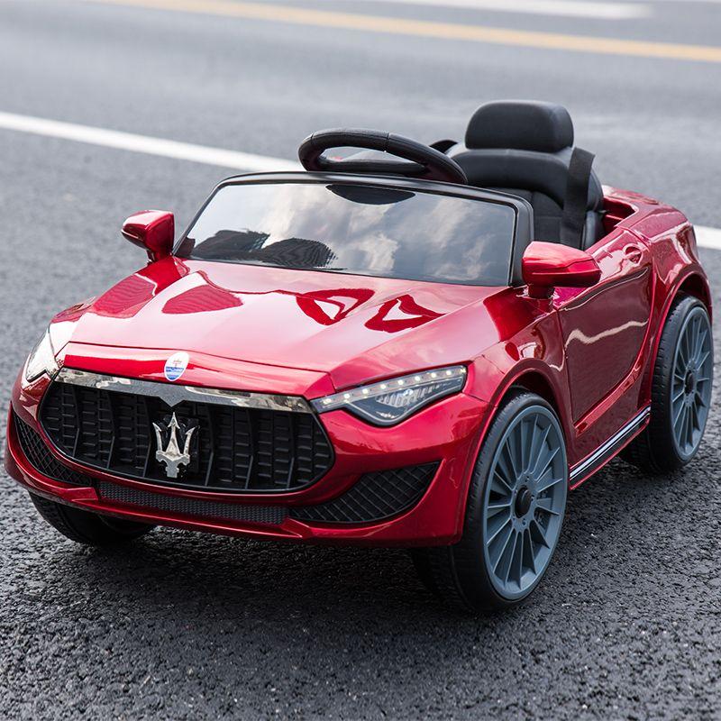 Spezielle preis kinder elektrische dual stick auto vier-rad fernbedienung können sitzen auto jungen mädchen baby schaukel spielzeug auto