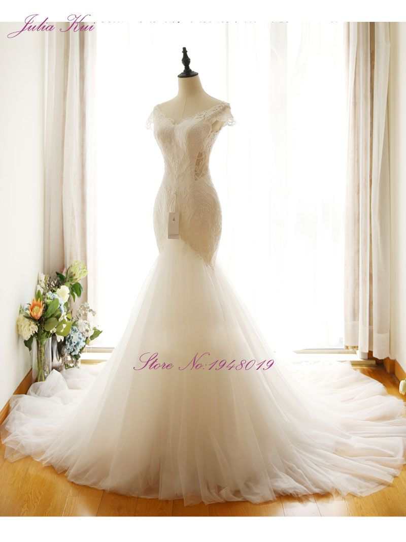 Mermaid Wedding Gown with Beaded V-neckline and Unique Appliques Ivory Wedding Dress Heavily Ruffled Organza Trumpet Bridal Gown