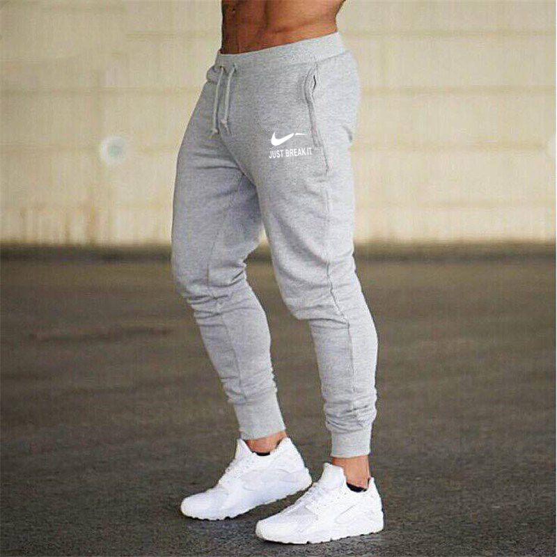 2018 Nouveau Hommes Joggers Marque Pantalons Masculins Pantalons Casual Pantalons de Survêtement Jogger gris Casual Élastique coton GYMNASES Fitness Workout pan