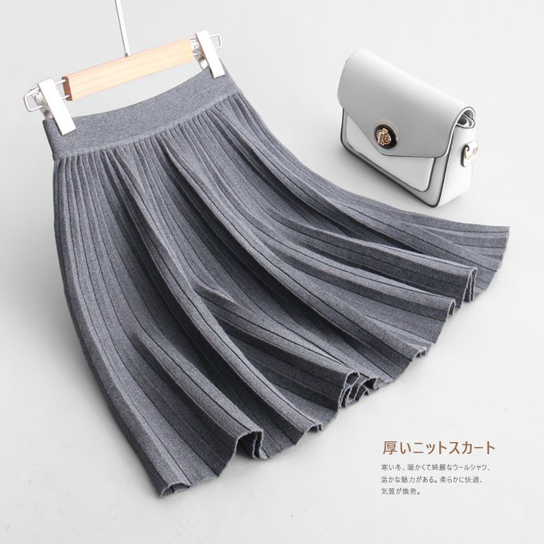 Nouveau de Femmes plissée mini jupe À La Mode élégant Automne-Hiver tricoté jupe solide couleur avec élastique taille