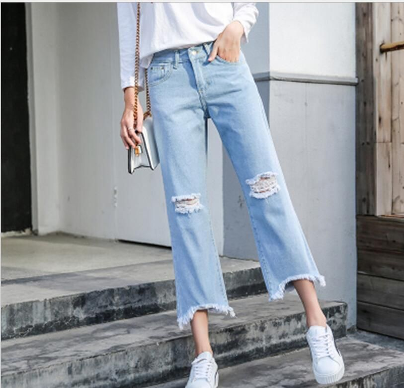 2018 spring and summer new Korean high waist personality hole tassel wild nine pants jeans