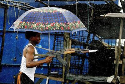 [Image: umbrella-ak47..jpg]
