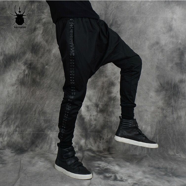 Men's brand stage fashion Rock fight skin rivets big crotch pants flying squirrel cross low crotch pants black male harem pants