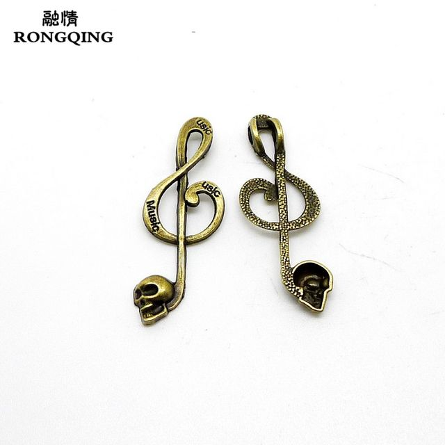 RONGQING 100Pcs/lot Antique Bronze Skull Music Note Charms 41x15mm Music Skull Pendant Jewelry Making