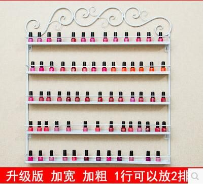 Nail art shop decorates the nail polish to receive a rack to display the function of the wall hang