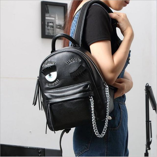 cartoon demon eyes backpack famous brand monster women leather backpacks metal chain school bag for teenagers travel backpack
