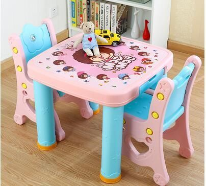 Study desk and chair set. Combination table. Children's plastic table of a set of desk and chair