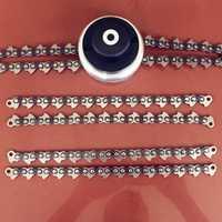 Nueva cabeza de bobina cadena cortador de cepillo de jardín con cabeza de engrosamiento cadena para césped