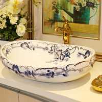 De alta calidad de cerámica sanitaria cuenca Cuenca del arte azul Oval campana mostrador cuenca Baño