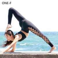 Alta calidad Chic Pantalones de Yoga las mujeres Sexy lado Cruz Leggings Yoga sólido entrelazado gimnasio pantalones Leggings de deporte