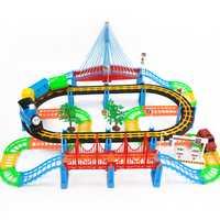 Envío libre 128 unids rompecabezas música eléctrica Luz de sonido juguete pista tren Thomas consta de avión, tren, autobús, árbol