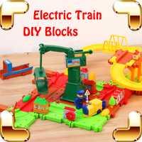 Nueva llegada regalo del favor del bebé tren ferrocarril eléctrico juguetes educativos DIY juego Blocs niños aprendizaje herramienta de enseñanza lujo presente