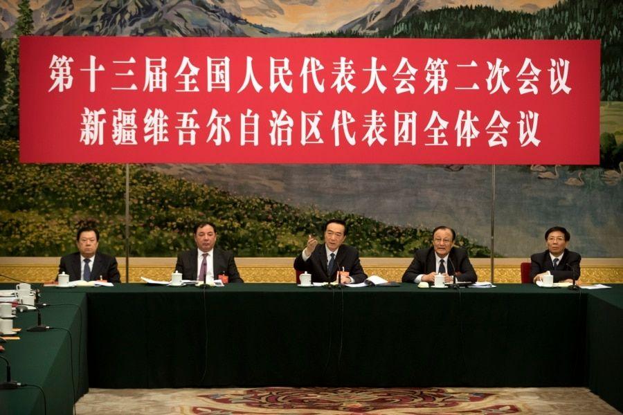 2019年3月12日在北京人民大会堂举行的全国人大会议新疆维吾尔自治区代表团会议上,新疆党委书记陈全国(中)讲话。
