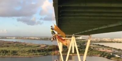 Greenpeace protesters who dangled from bridge over vital ship channel arrested and CHARGED!