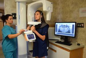 Taking dental x-rays.