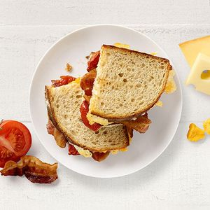 Cheesy Bacony Deliciousness! Try our new Bacon Tomato Grilled Cheese