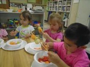 Making fruit kabobs helps our Discovery Preschoolers develop hand-eye coordination and fine motor skills.