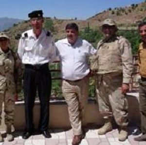Pictured: Captain Steve Haddad (second from right) with members of his unit and some locals in Iraq.