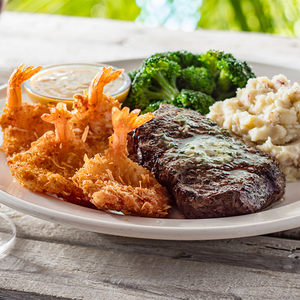 Top Sirloin & Coconut Shrimp - Our top sirloin paired with coconut shrimp, mashed potatoes and broccoli.