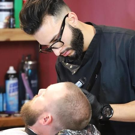 Looking to get a clean cut and shave? Book an appointment with us today!