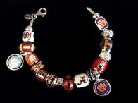 We carry collegiate Persona beads. You can custom make your own bracelet or necklace!