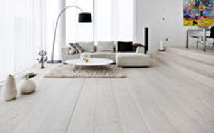 White is pristine yet inviting in this living room featuring a white wash oak floor with a European oil finish for durability.