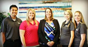 Our dentist, Dr. Lori Logsdon, DDS with the staff at Bright Smiles Dental.