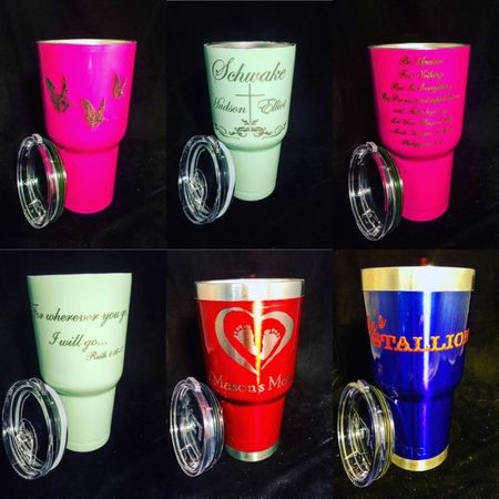Custom powder coated mugs with engraved personalization.