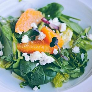 Citrus salad with microgreens and goat cheese.