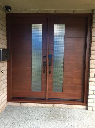 A fun pair of African Mahogany entry doors!