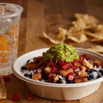 A burrito bowl topped with freshly grilled adobo chicken brings the flavor!