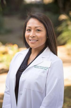 Dr. Dominique Butawan-Ali - board-certified obstetrician and gynecologist
