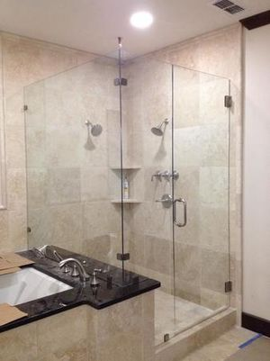 Kerrville's top choice for residential & commercial glass services, including shower doors & enclosures, custom glass table tops & shelving, and mirrors as well as window installation, window repair, re-screening, and commercial glass installation.  Contact us today for more information or to schedule service!