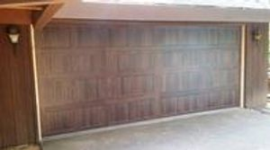 Carriage House Stamp Garage Door with Mahogany Accent Finish