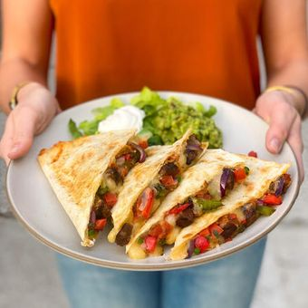 Grilled quesadillas are stuffed with chef-selected ingredients like grilled steak and hand-sliced, sautéed-in-house fajita vegetables.