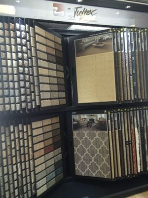 Browse a variety of flooring including hardwood, engineered wood, carpet, tile and stone, at our local flooring store.