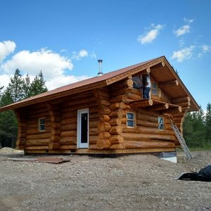 Finishing touches on a small cabin