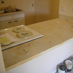 Stained old formica Countertop BEFORE resurfacing