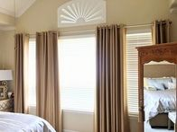 We offer custom window treatments including drapery, shades, blinds and more!