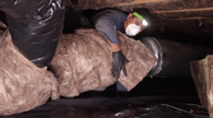 One of our fantastic crew members wrapping a duct!